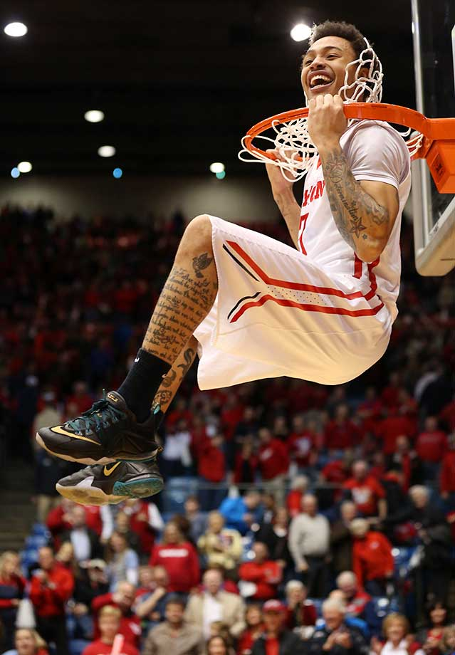 Kyle Davis celebrates after Dayton defeated VCU to win a share of the Atlanta 10 Conference.