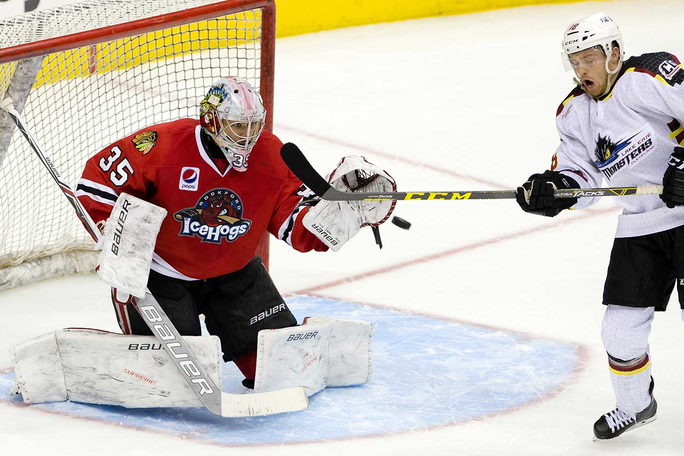 Rockford IceHogs goalie Mac Carruth stops a Lake Erie shot.