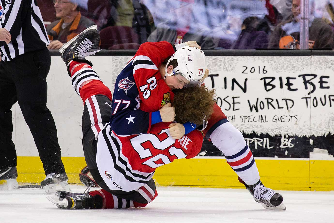 Josh Anderson (77) of Lake Eerie and Pierre-Cedric Labrie of Rockford fight during an AHL game in Cleveland.