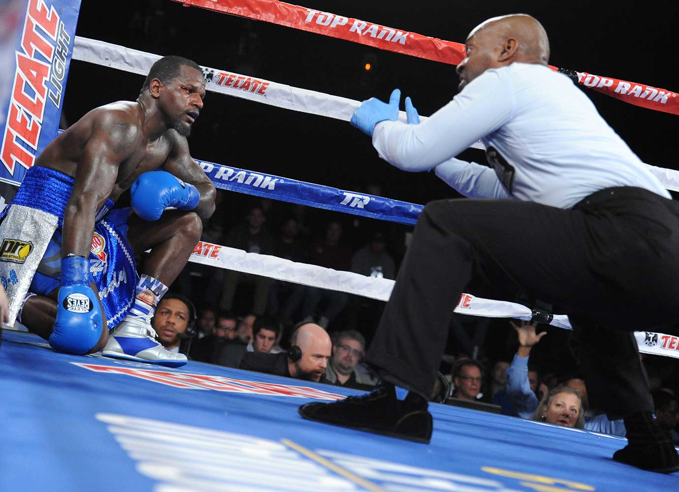 Henry Lundy receives a standing 10-count as Terrance Crawford retained the WBO Lightweight title by TKO of Round 5.