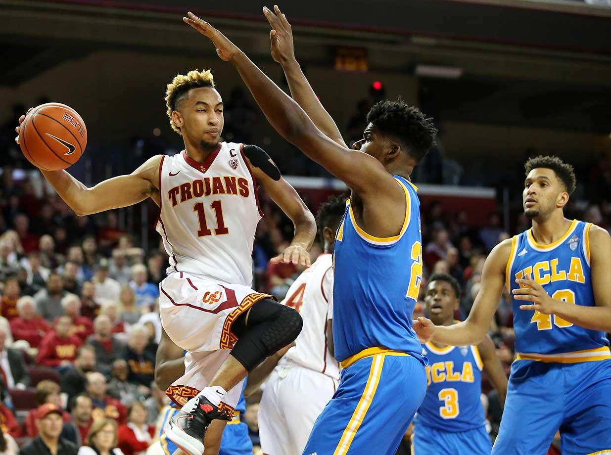 USC Trojans guard Jordan McLaughlin makes a pass under the basket a game against the UCLA Bruins at Galen Center.