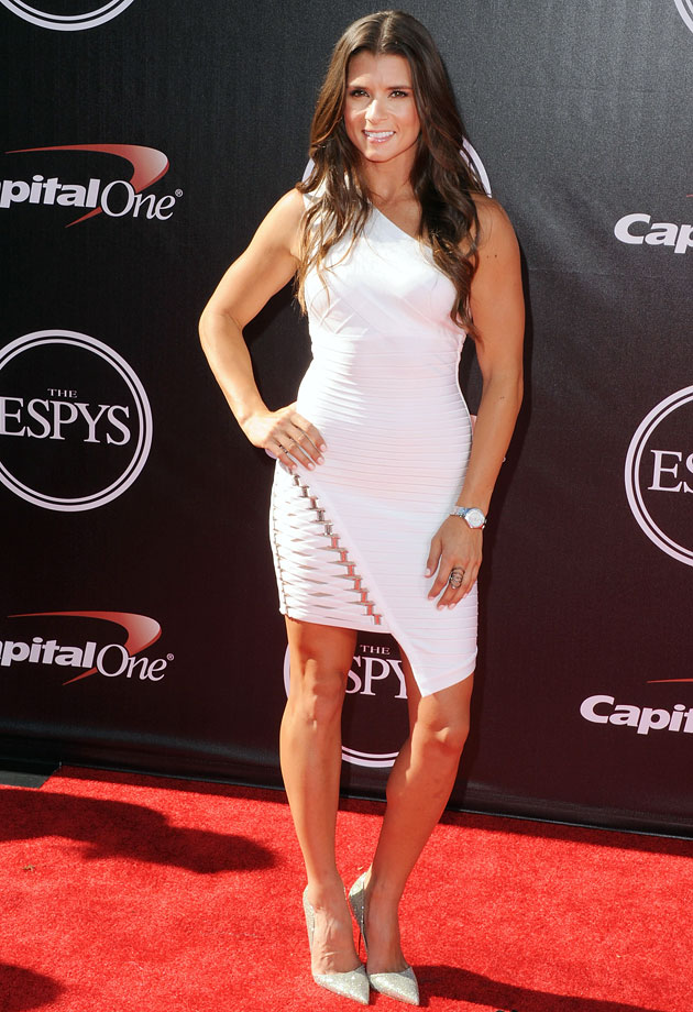 Temperatures inside a NASCAR cockpit can reach over 120 degrees, but in this white asymmetrical dress, Danica Patrick looks just as hot off the track.