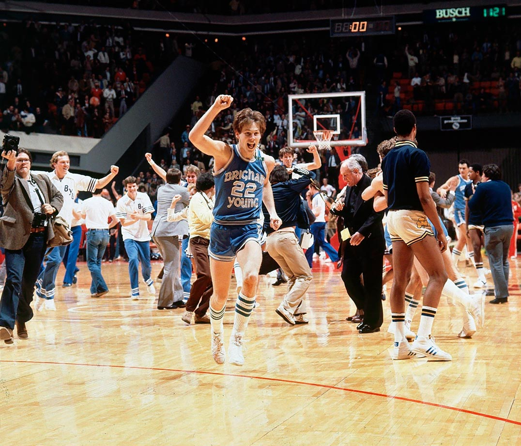 With a coast-to-coast drive, Ainge carried Brigham Young further into the NCAA tournament than the Cougars had ever gone. Trailing Notre Dame 50-49 with eight seconds remaining in the 1981 Sweet 16, Ainge took the inbounds pass the length of the court, sprinting past defenders to hit a layup to win the game. Ainge helped BYU make three NCAA tournaments in his college career, leading the Cougars in scoring each year. The 1981 first-team All-America and Wooden Award winner finished his career with a scoring average of 20.6 points per game.
