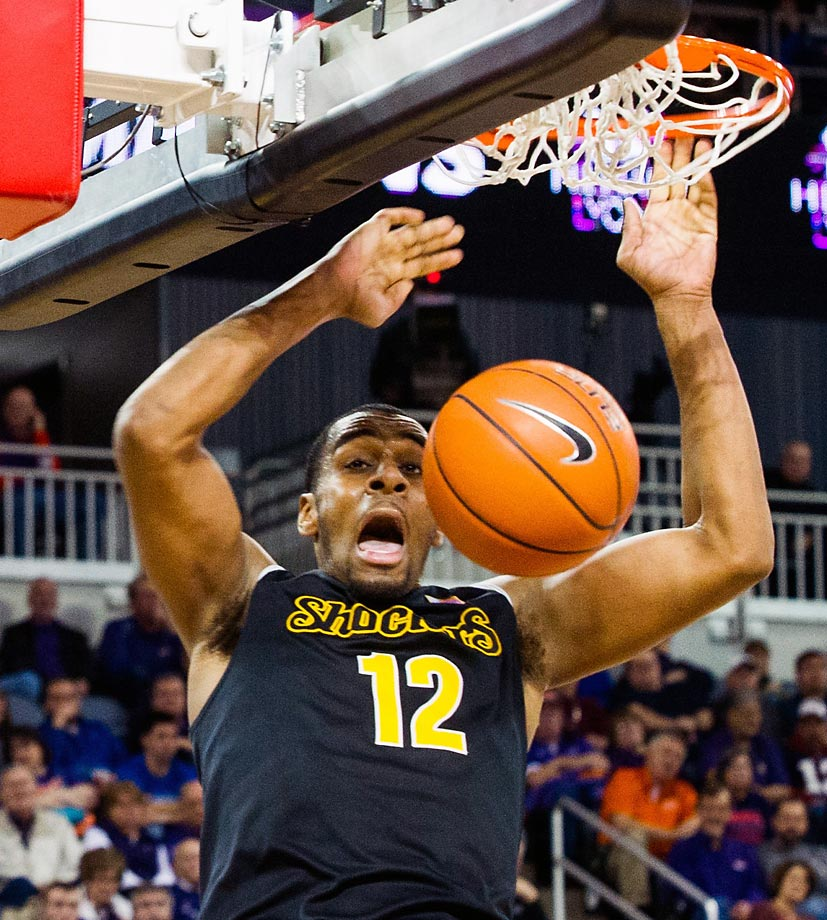 Wichita Stateís Darius Carter dunks against Evansville.