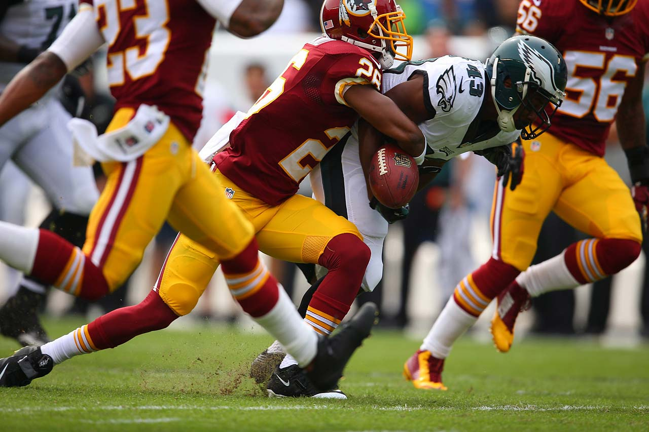 Darren Sproles has the ball stripped from his grip during the Eagles 37-34 win over Washington.