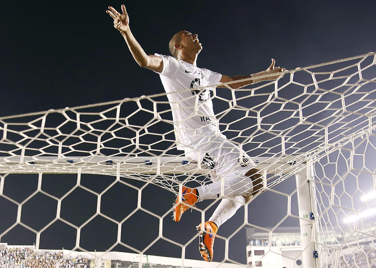 David Braz of Santos celebrates at end of the final match of the Sao Paulo State soccer league against Palmeiras. Santos won in a penalty shootout after tying 2-2 on aggregate.