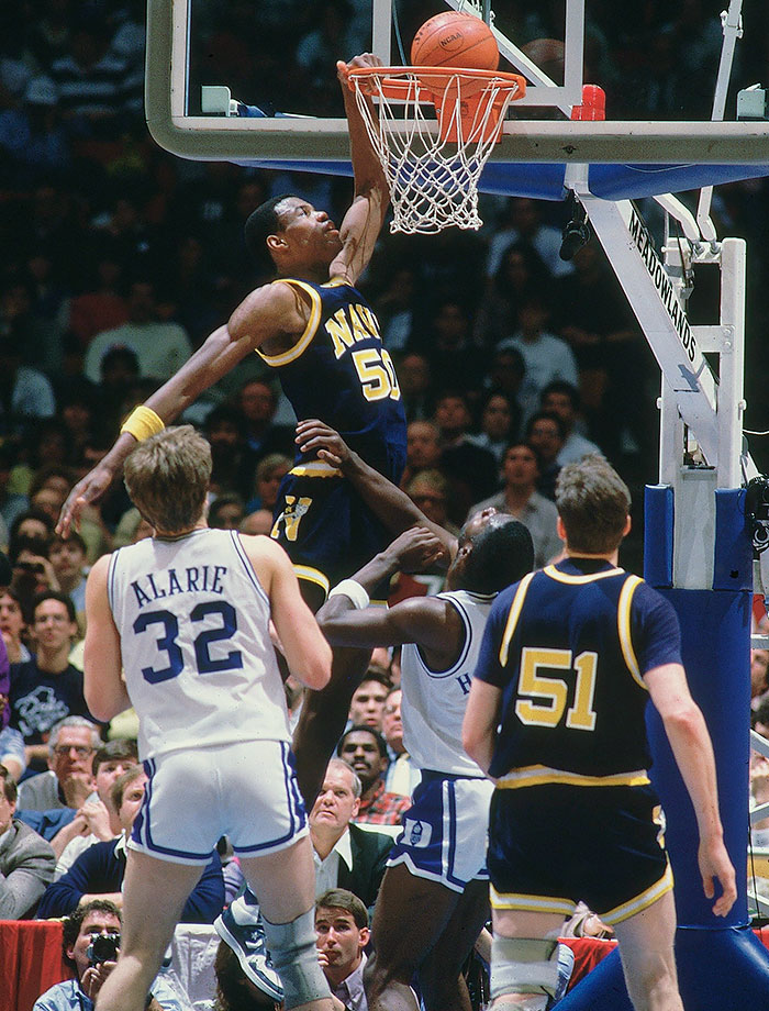 "Robinson was a late bloomer, both in height and basketball. As a senior in high school he was 6-7, but after he went to the U.S. Naval Academy, he grew to over seven feet. ""The Admiral"" set the NCAA record for blocks in a season (207) as a junior. The Midshipmen reached the Elite Eight in 1986 with Robinson averaging 27.5 points and 11.8 rebounds, and he had 23 points and 10 rebounds in the Elite Eight loss to Duke. The following year, Robinson scored 50 points in a first-round loss to Michigan."