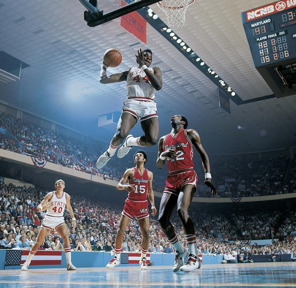 "A decade before the world first heard the phrase ""Air Jordan,"" basketball fans were dazzled by ""Skywalker"" Thompson, who had a 48-inch vertical leap and was on the finishing end of many alley-oops from Monte Towe. Though the dunk was against the rules at the time, Thompson's acrobatics propelled the Wolfpack to the 1974 championship. Their run to the title included an overtime win over No. 4 Maryland, widely considered the greatest game in ACC history, and a double-overtime victory over Bill Walton-led UCLA in the semifinals in which Thompson had 28 points and 10 rebounds. Thompson's Wolfpack might have won two titles if they weren't ineligible in 1973 because of NCAA sanctions."