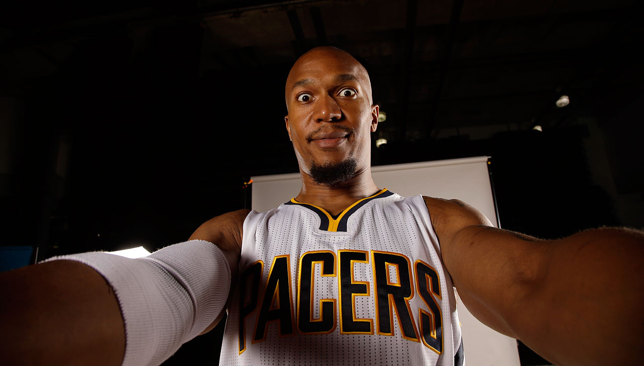 Right before taking this picture, a photographer showed David West the Pacers' 2014-15 roster.