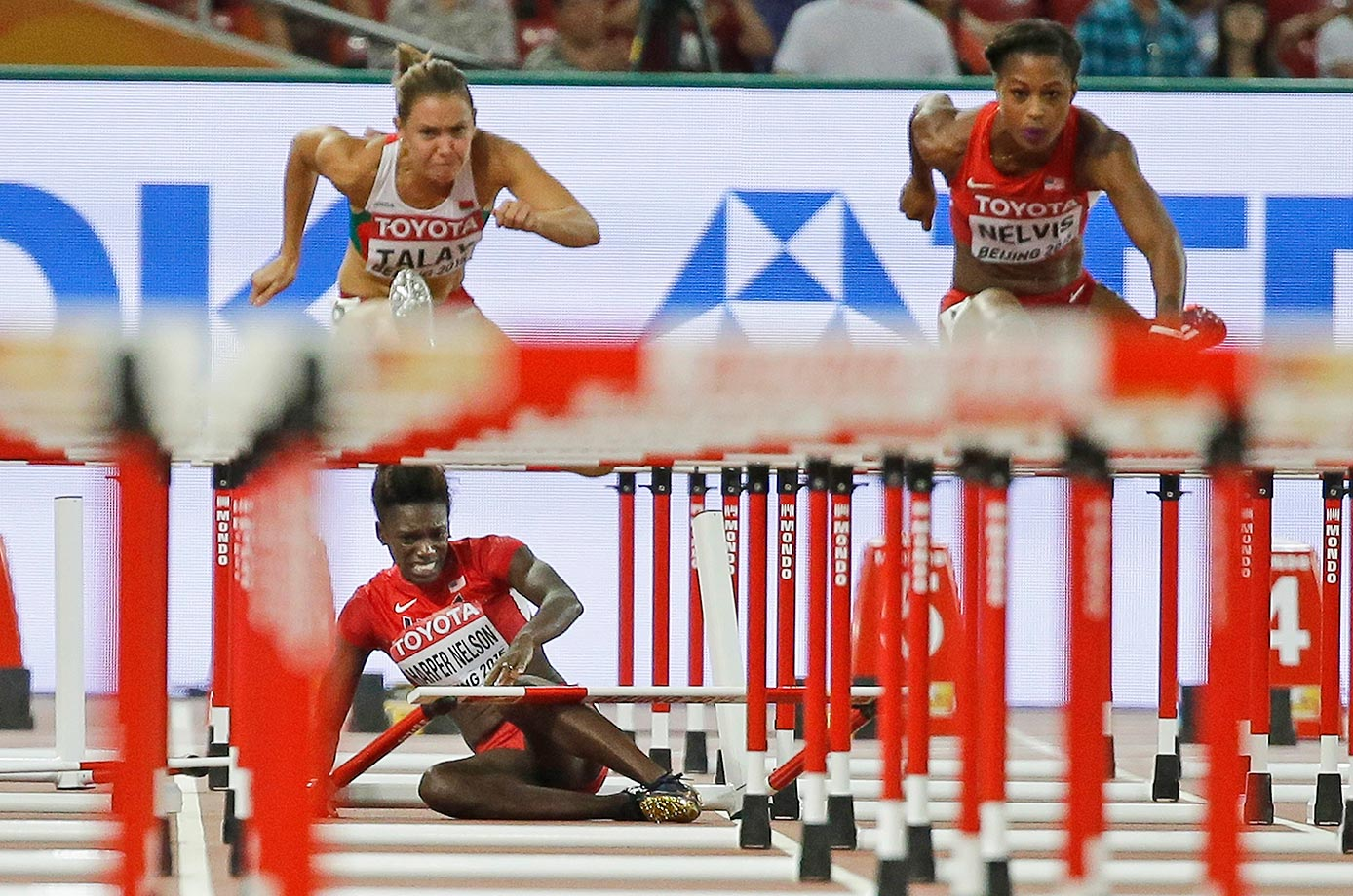 Dawn Harper Nelson of the U.S. sits on the track after hitting a hurdle in the 100m hurdles semifinal in Beijing.