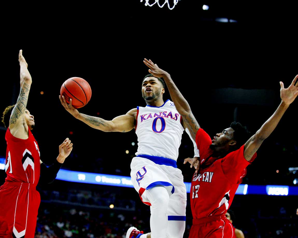 Kansas guard Frank Mason III splits the Austin Peay defense to put up a shot.
