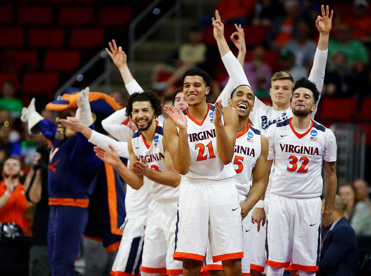 The Virginia bench cheers on the starters in a win over Hampton.