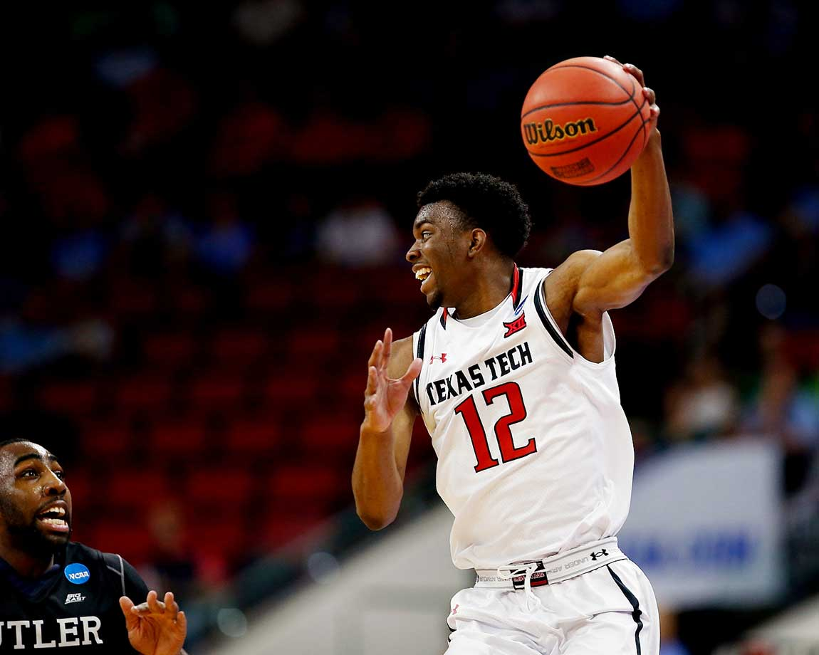 Keenan Evans of the Texas Tech Red Raiders keeps the ball out of the hands of Butler.