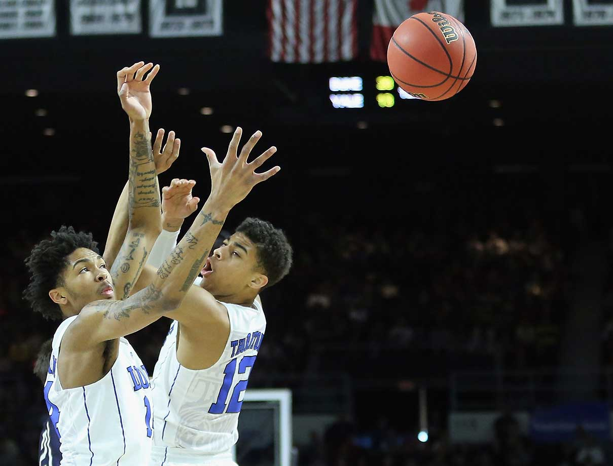 Brandon Ingram (14) of Dukeand teammate Derryck Thornton reach for a rebound.