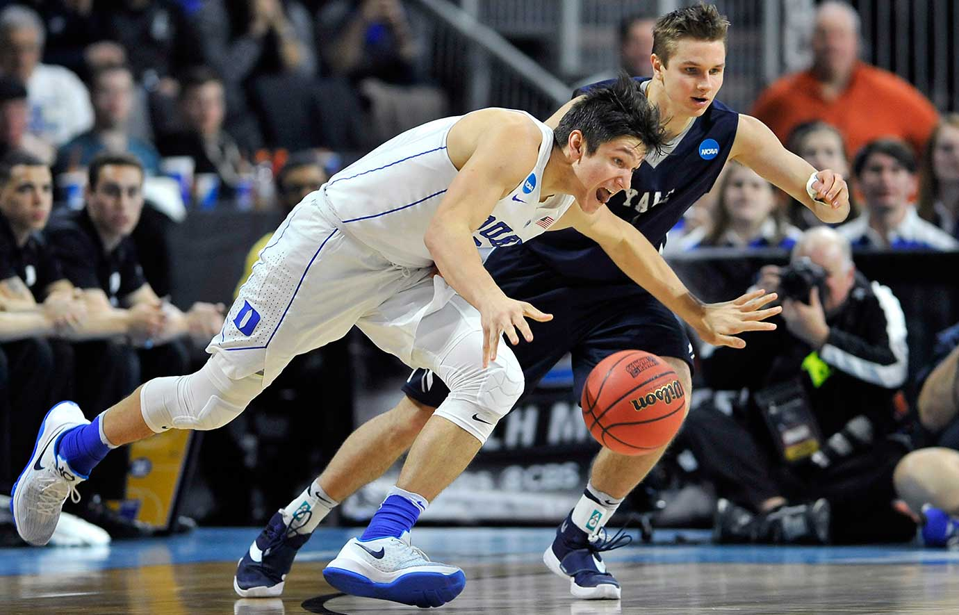 Duke's Grayson Allen loses control of the ball as Yale's Makai Mason defends. Duke advanded, 71-64.