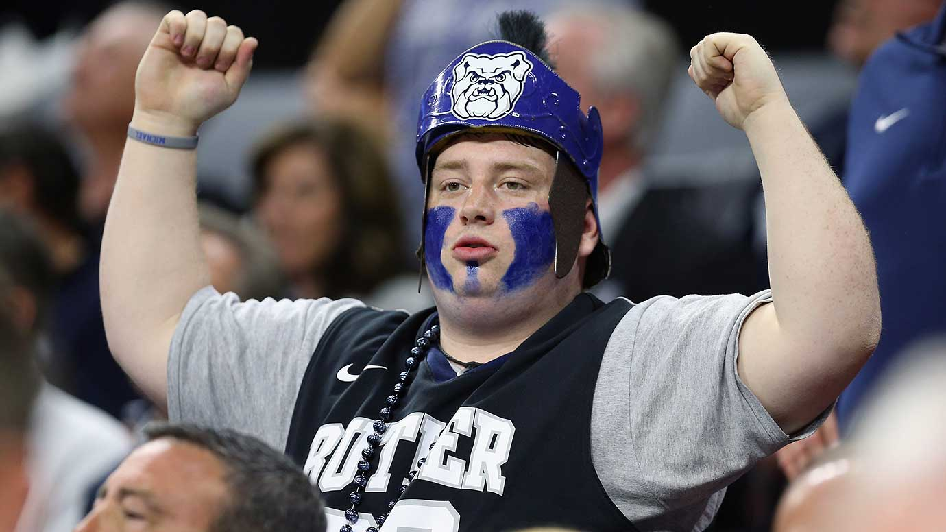 A Butler fans cheers on the Bulldogs to no avail in their 77-69 loss to Virginia.