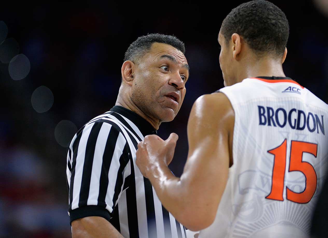 Malcolm Brogdon of Virginia talks with a referee as the Cavs advanced to the Sweet 16 for the second time in three years.