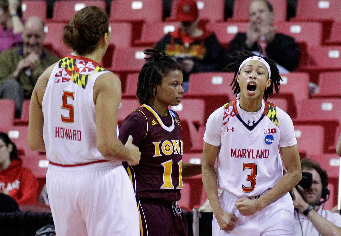 Maryland guard Brene Moseley, right, and Malina Howard react in front of Iona guard Philecia Gilmore.