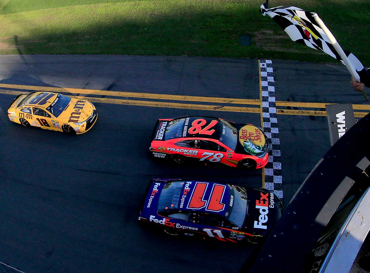 Denny Hamlin takes the checkered flag ahead of Martin Truex Jr. in the 2016 Daytona 500, the closest finish in the history of the race.
