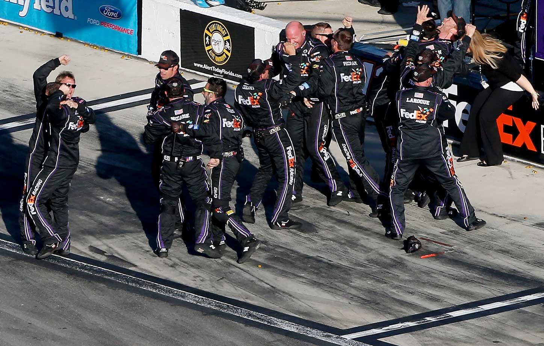 Crew members of Denny Hamlin were ecstatic after realizing he had won a photo-finish Daytona 500.
