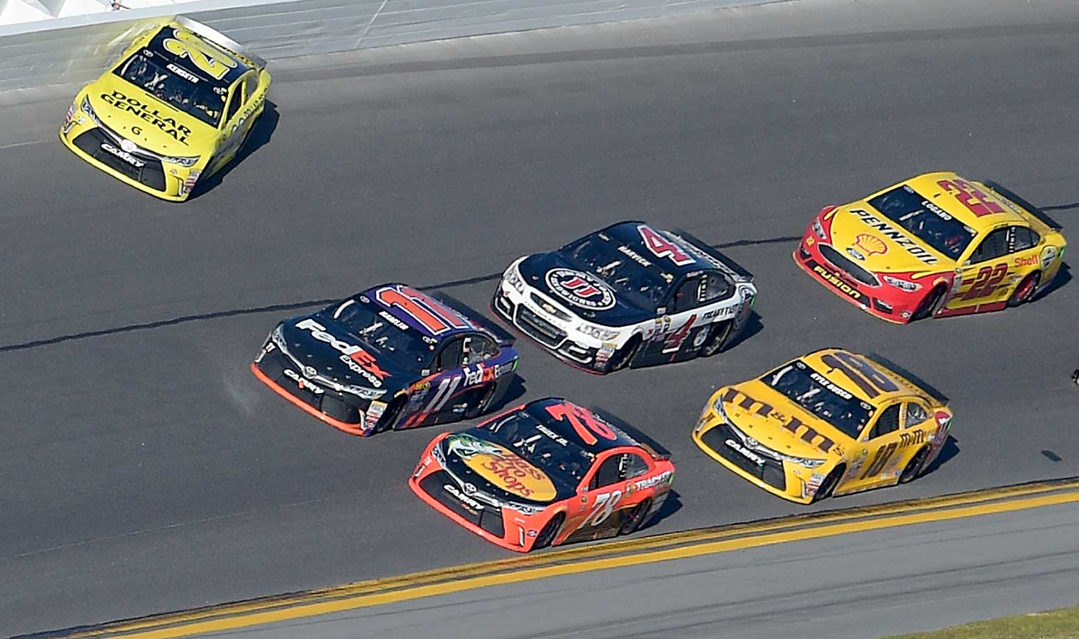 Matt Kenseth (top left) failed in his attempt to block Denny Hamlin (11) and faded from second to 14th in the final moments.