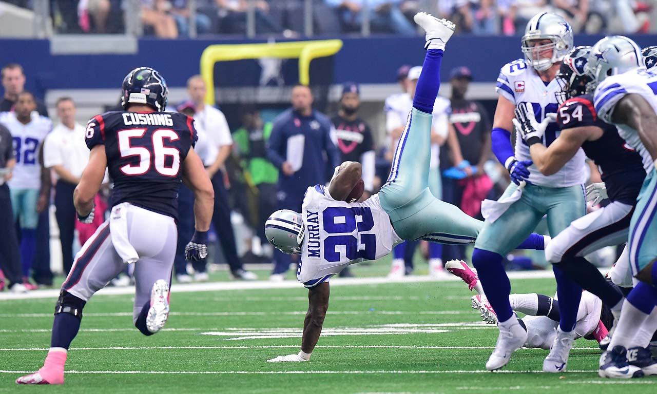 The leagu'e's leading rusher through five weeks, DeMarco Murray tries to break his fall during an overtime win over Houston.