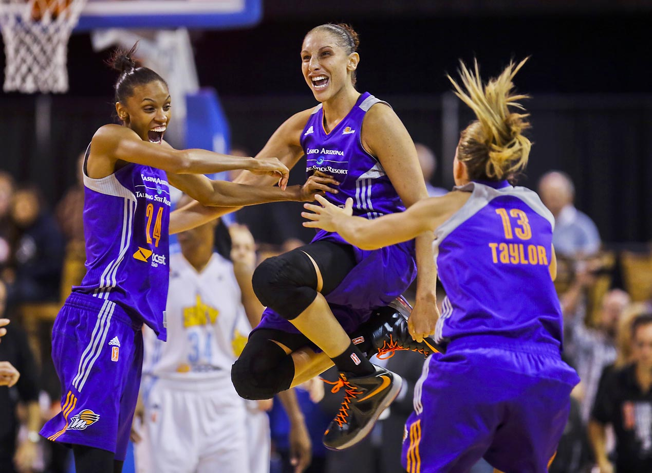 DeWanna Bonner (24) celebrates with Diana Taurasi and Penny Taylor after the Phoenix Mercury won the WNBA championship. They defeated Chicago Sky 87-82 in the clinching game.
