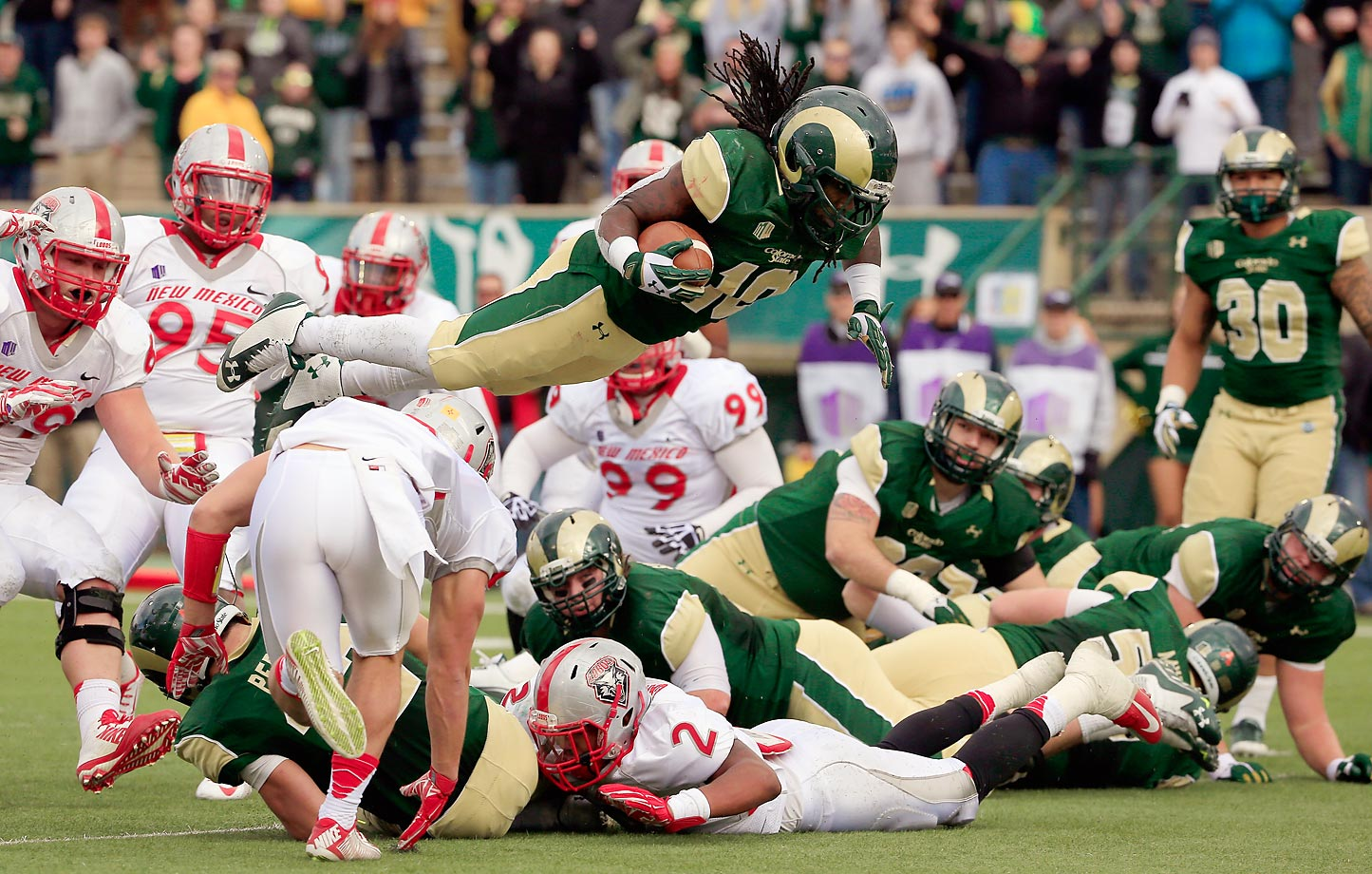 Dee Hart of the Colorado State Rams dives into the endzone on fourth down for a touchdown to take a 14-0 lead against the New Mexico Lobos. Hart had 272 yards total offense and six touchdowns as Colorado State defeated New Mexico 58-20.