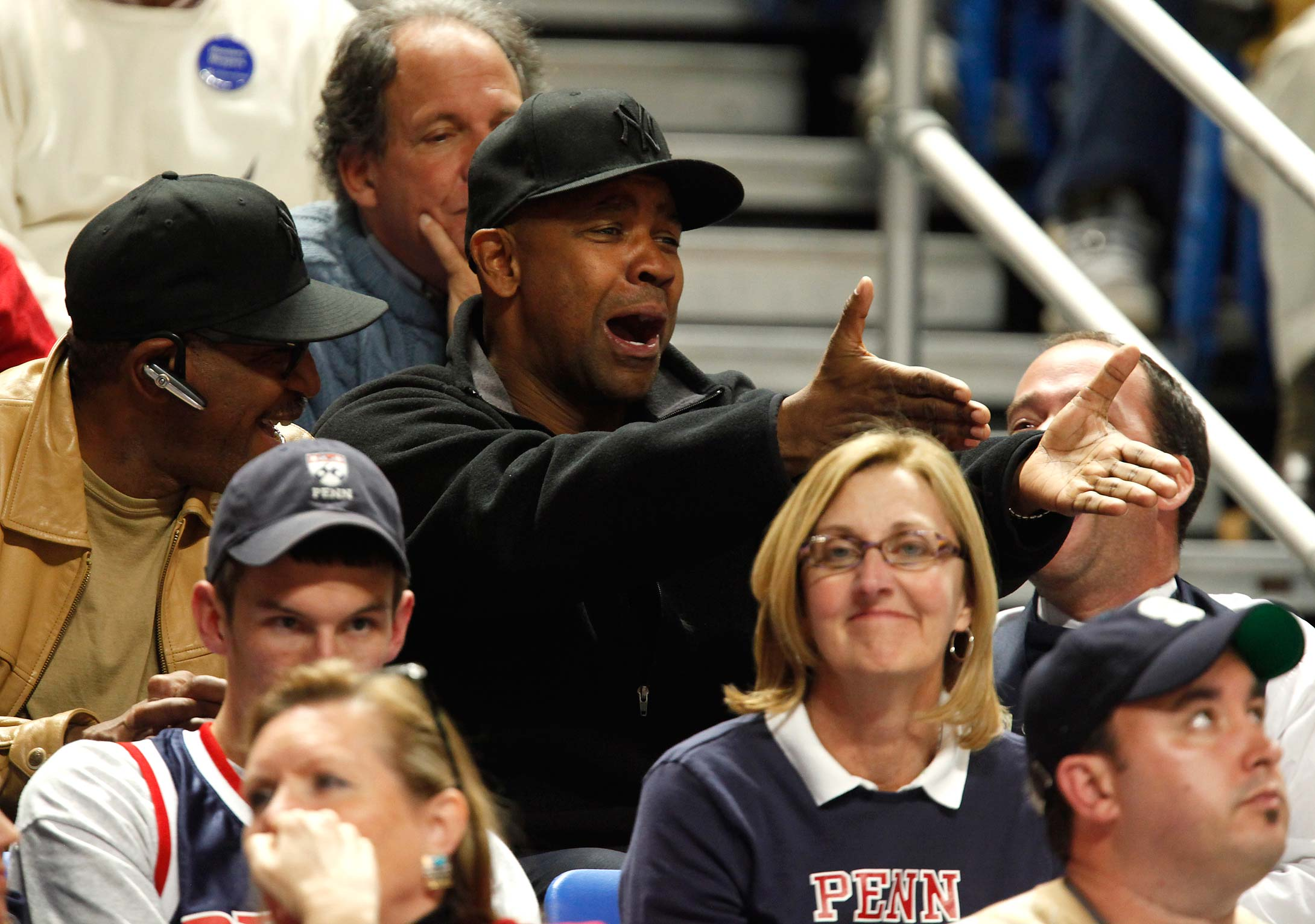 Denzel Washington reacts as he watches Penn play Penn State in State College, Pa., in 2009. Washington's son Malcolm played at Penn.