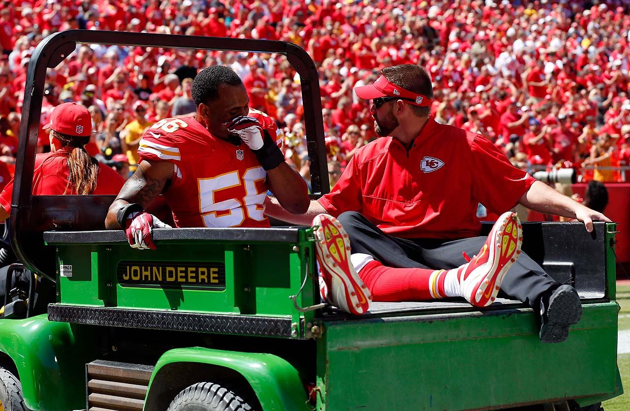 Derrick Johnson of the Kansas City Chiefs reacts as he is taken off the field during the first half of the game against the Tennessee Titans. He injured his Achilles and could be out for the remainder of the season.