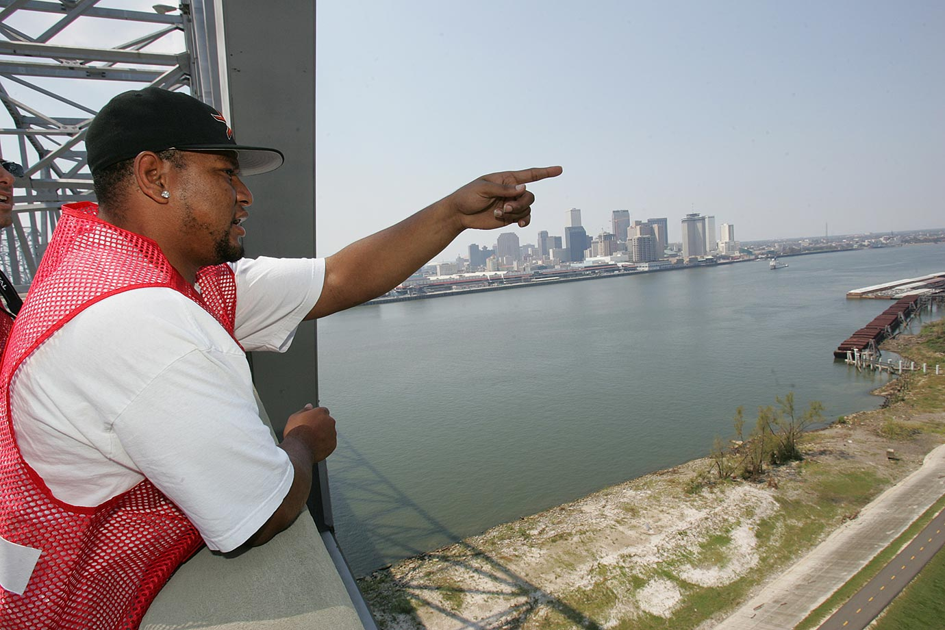 "Sept. 4, 2005: Saints running back Deuce McAllister surveys the damage in New Orleans after Hurricane Katrina. ""I had an opportunity to go back that Saturday and do stuff for the Red Cross,"" said McAllister. ""Even to think we considered these people refugees. They were not refugees; they were people who lost their homes. When someone loses their home in a fire we don't use that term. These people were American citizens who just lost their homes. To think they could not get help. To think we were responding in the manner we were was really mind-boggling."""
