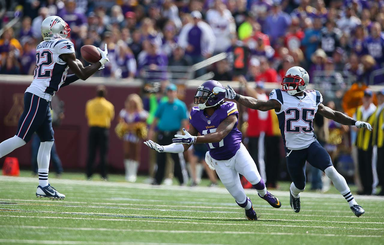 Patriots strong safety Devin McCourty intercepts a pass intended for Minnesota Vikings wide receiver Jarius Wright.