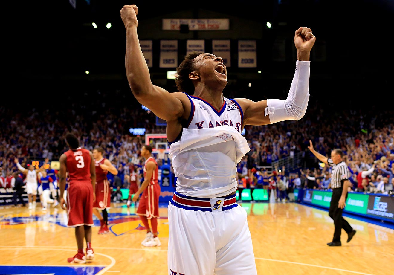 Devonte' Graham of Kansas celebrates after his team won a three-overtime thriller against Oklahoma.
