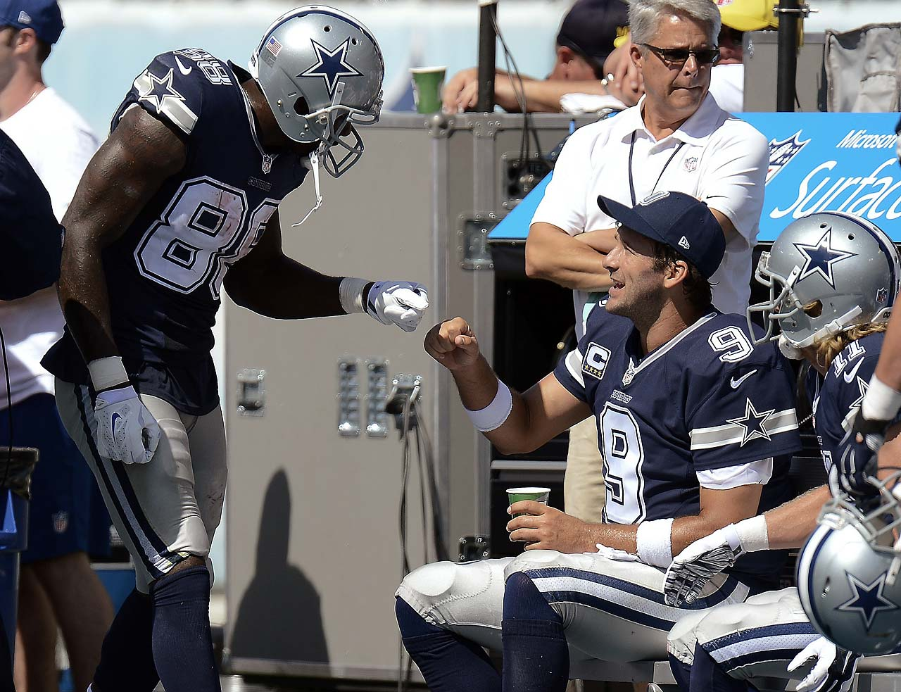 Dallas Cowboys quarterback Tony Romo and wide receiver Dez Bryant celebrate after they connected on a three-yard touchdown pass.