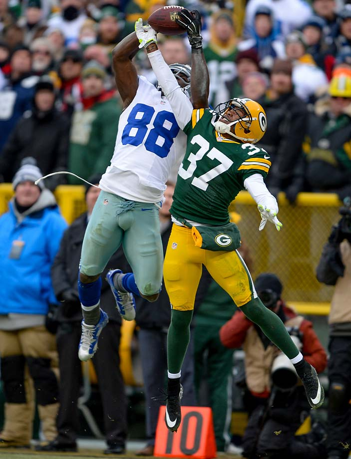 Dez Bryant went up high to snag a ball over Sam Shields, but what happened afterward will forever be the subject of debate.