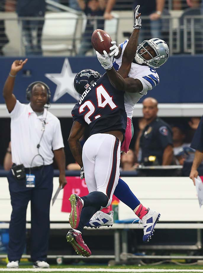 Dez Bryant  makes a difficult pass reception against  Johnathan Joseph of the Houston Texans in overtime to set up the Cowboys' game-winning field goal.