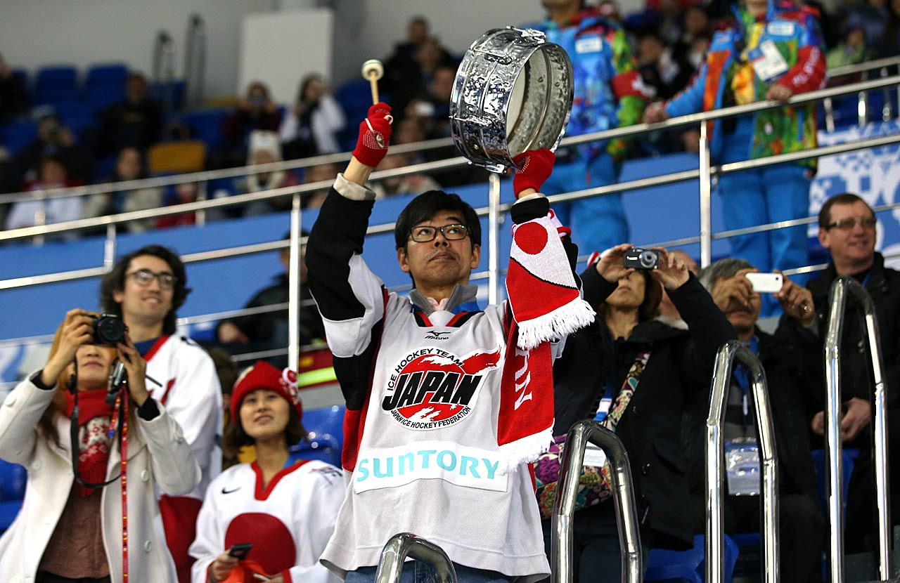 Japanese fans cheer during their team's hockey game against Sweden.