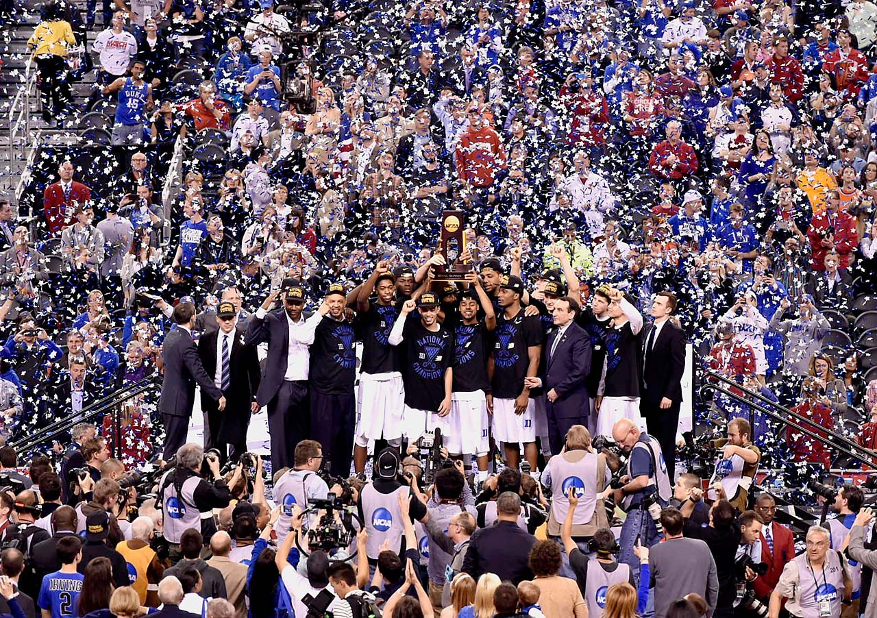 Quinn Cook (holding trophy) and the rest of the Duke squad pose amidst cheers and confetti with their national championship prize.