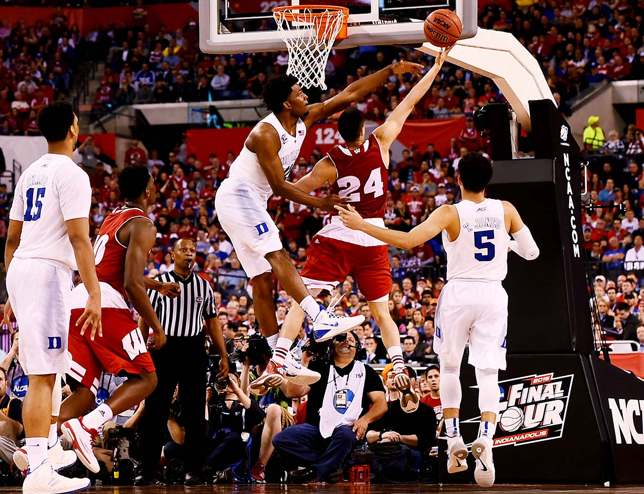 Wisconsin guard Bronson Koenig attempts to lay the ball in over Duke forward Justise Winslow. Koenig scored 10 points on 4-9 shooting.