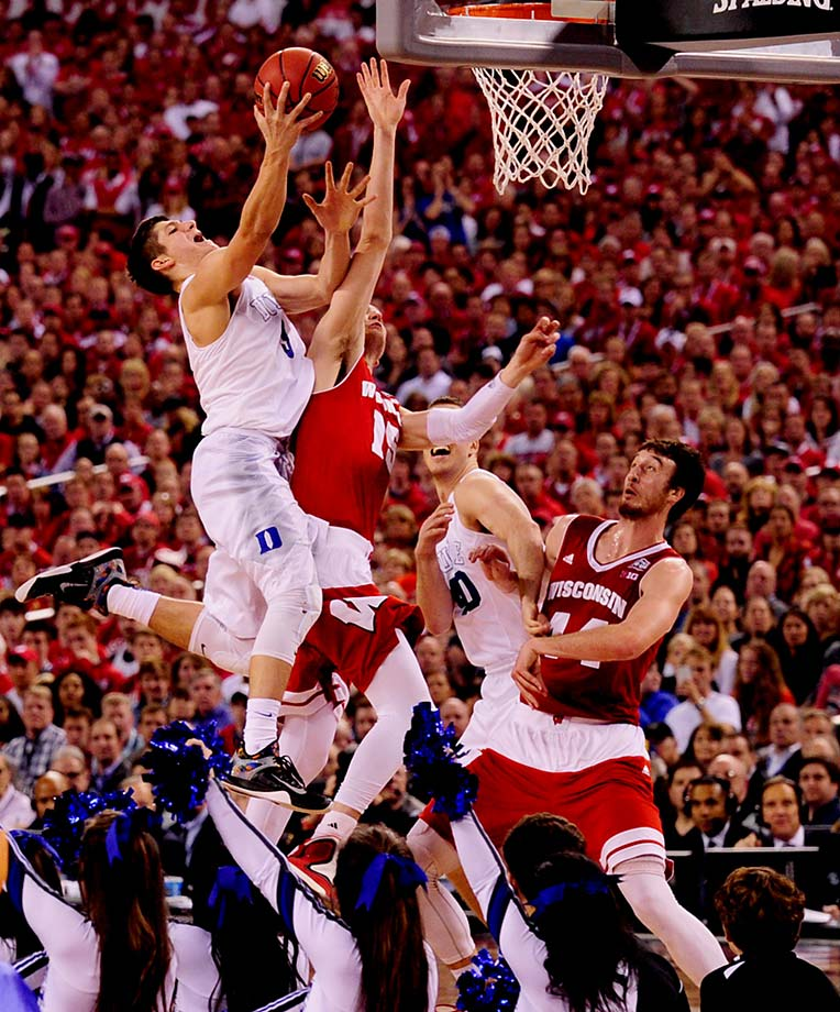 Grayson Allen flies toward the backboard over the contest of Wisconsin's Sam Dekker. Allen was among Duke's heroes Monday despite averaging only 4.4 points per game on the season.