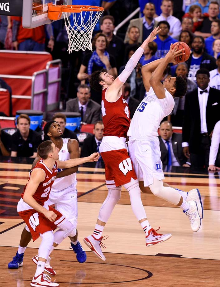 In a matchup of arguably the nation's two best players, Frank Kaminsky put up the stats but Jahlil Okafor and Duke got the victory.