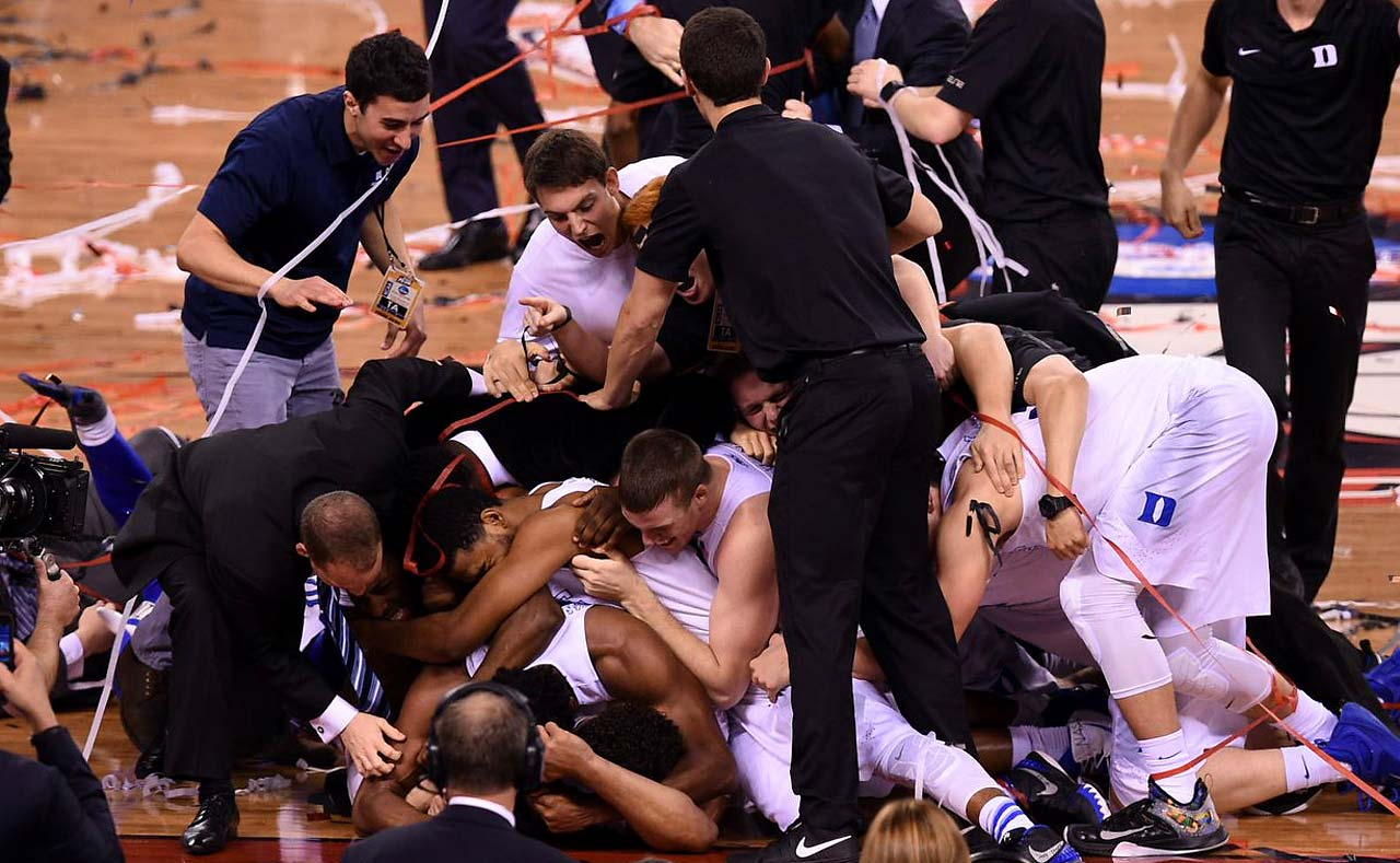 Duke players pile on each other in celebration in the moments following their 68-63 national title game triumph over Wisconsin.