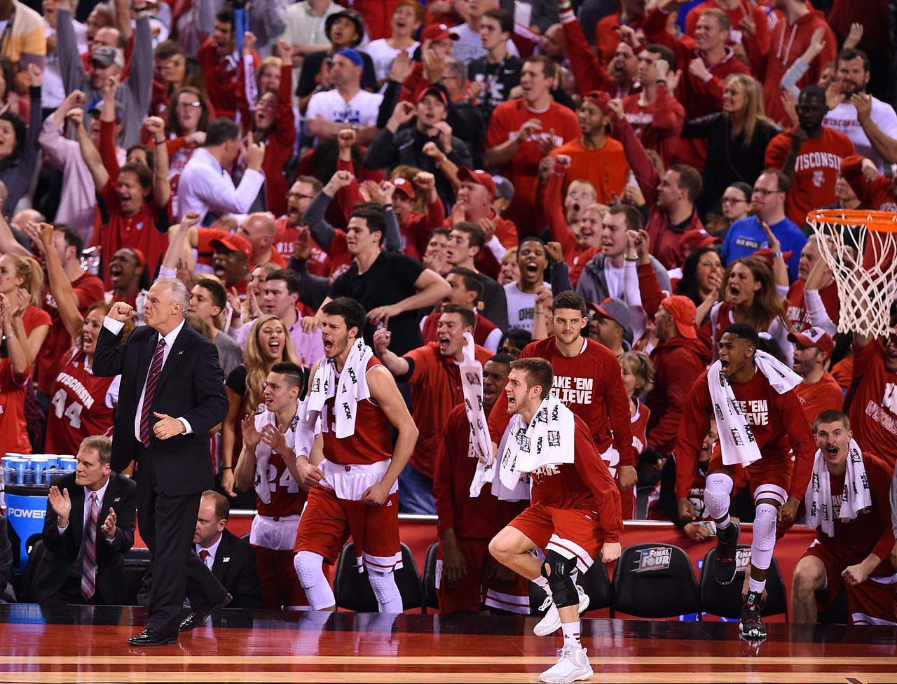 Wisconsin's bench celebrates a big play during Monday's title game. The Badgers led by as many as 9 points in the second half before falling 68-63.