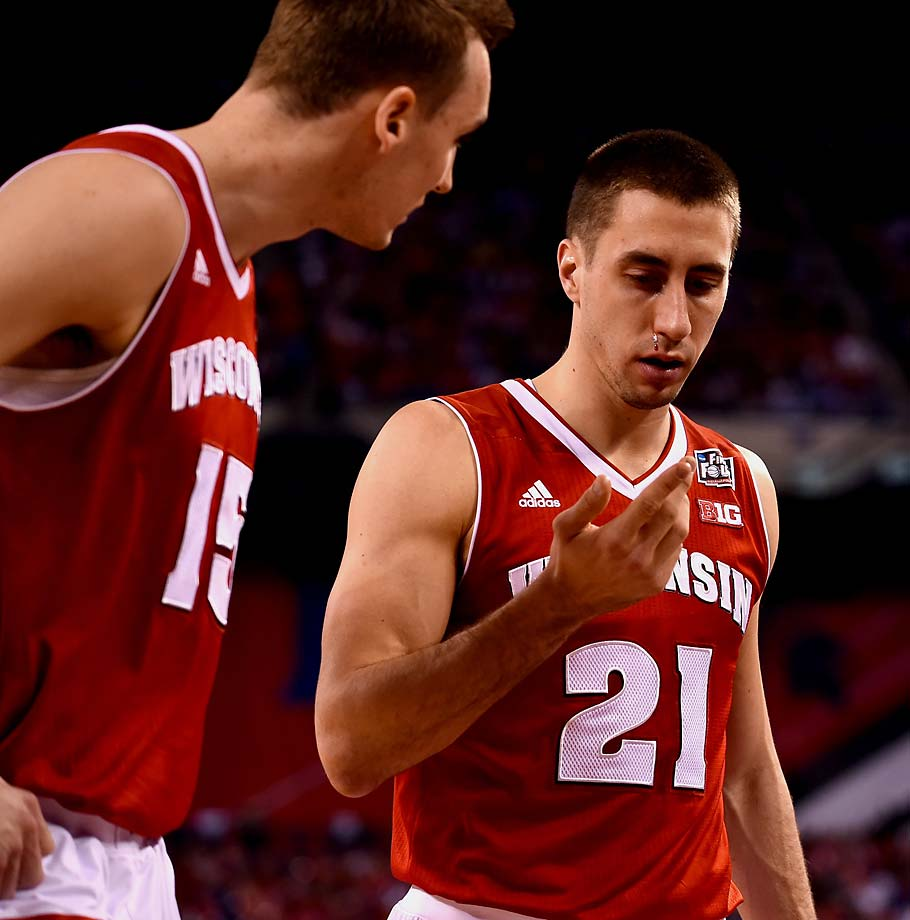 Wisconsin's Josh Gasser discovers blood on his face during his team's championship game loss. The senior was held scoreless on one shot in his final college game.