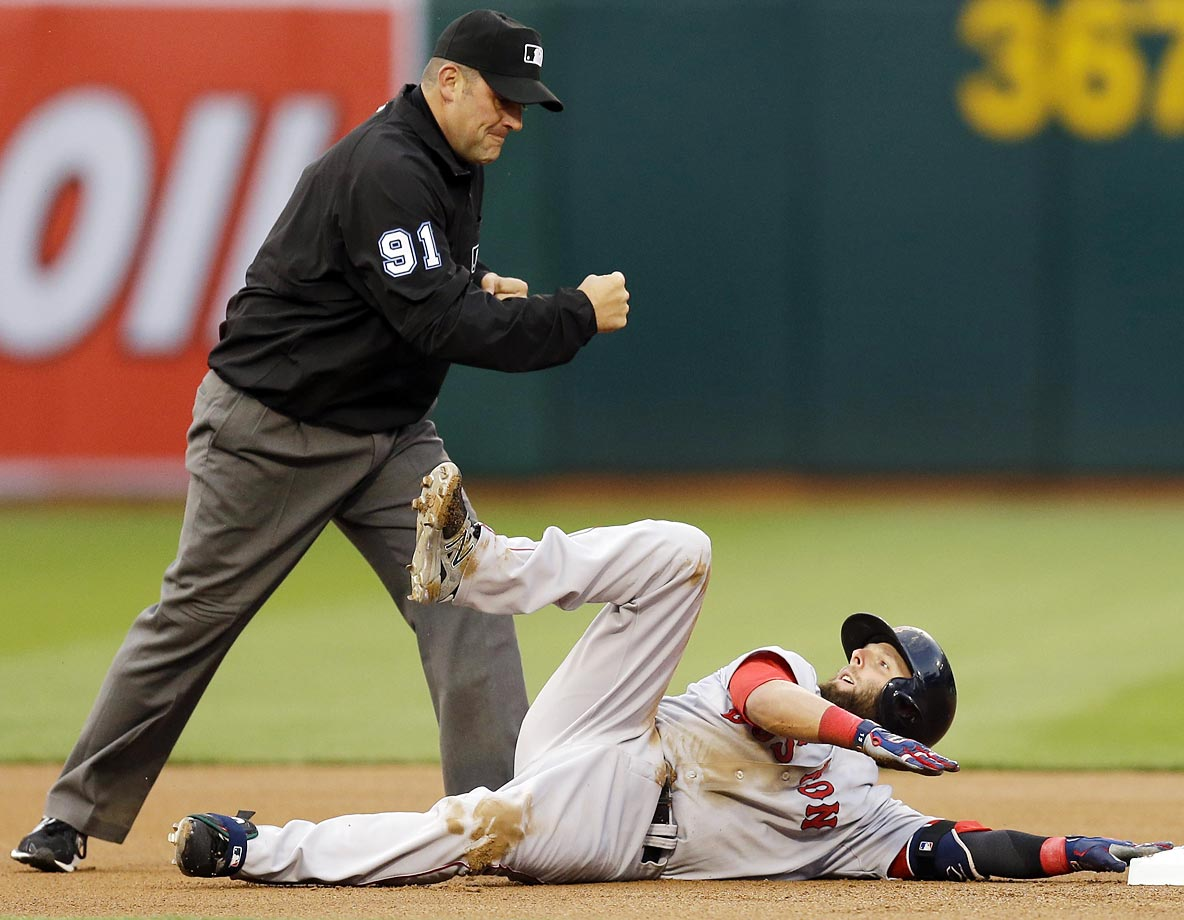 Red Sox infielder Dustin Pedroia is called out at second base in a game against the A's.
