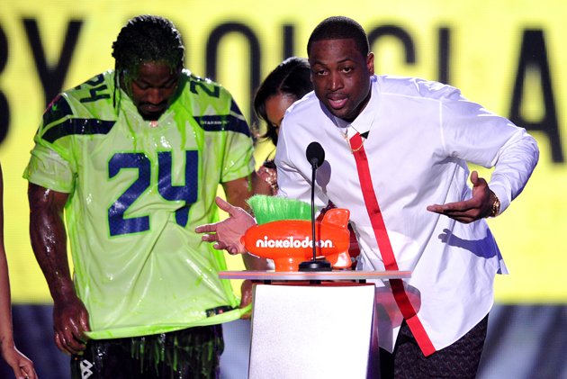 "At the Kids Choice Awards, Dwyane Wade accepted ""King of Swag"" while Marshawn Lynch got slimed."