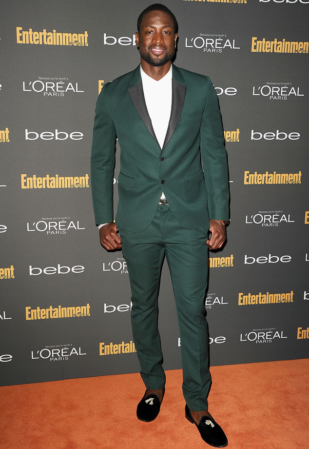 As if Dwyane Wade isn't wearing your grandpa's loafers – he paired his cool kicks with a statement green suit for an unforgettable look.
