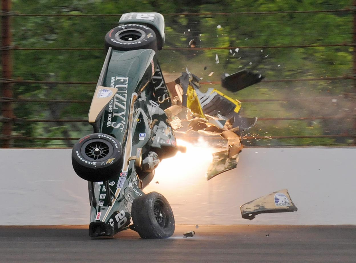 Ed Carpenter hits the wall during a practice before qualifications for the Indianapolis 500.  Carpenter was not injured.
