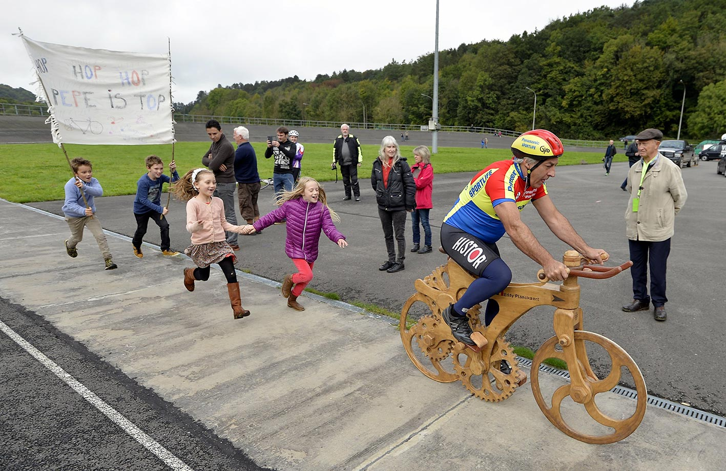 Eddy Planckaert, a former cyclist for Belgium, attempts to break the world hour record on a wooden bike at the velodrome in Jemelle, Rochefort, Belgium.