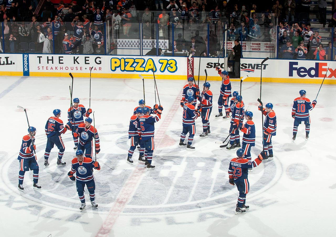 The Oilers salute their fans after winning their first game, six games into the season, on Oct. 20 against the Lightning.